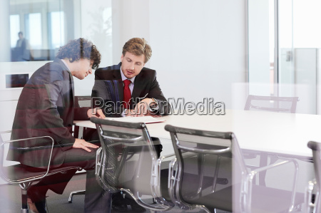 businessmen sitting at conference room table