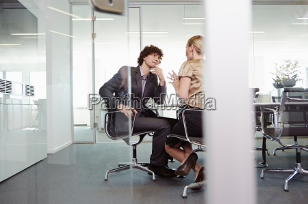 businessman and woman having meeting at