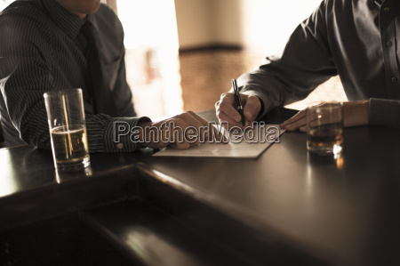 partners signing business contract in a