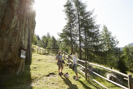 young rock climbing couple preparing to