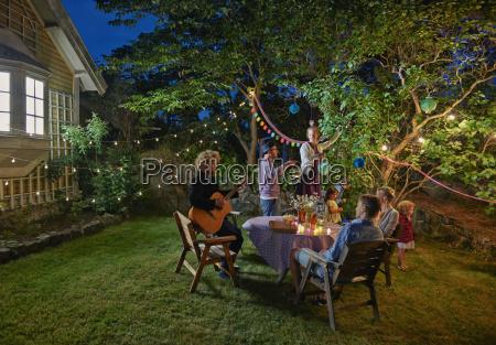 family group preparing for evening garden