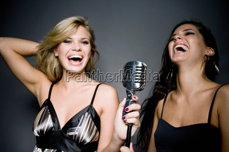 two women with mic laughing