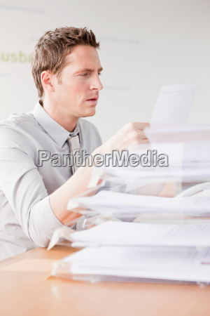 man looking at papers