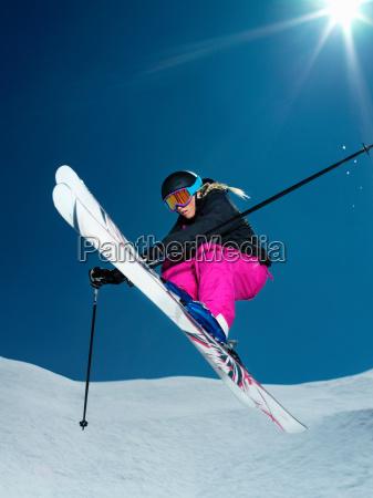 female skier jumping