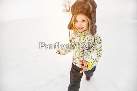girl wearing furry hat walking in