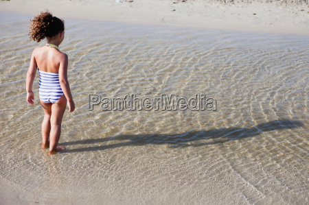 young girl playing in water at