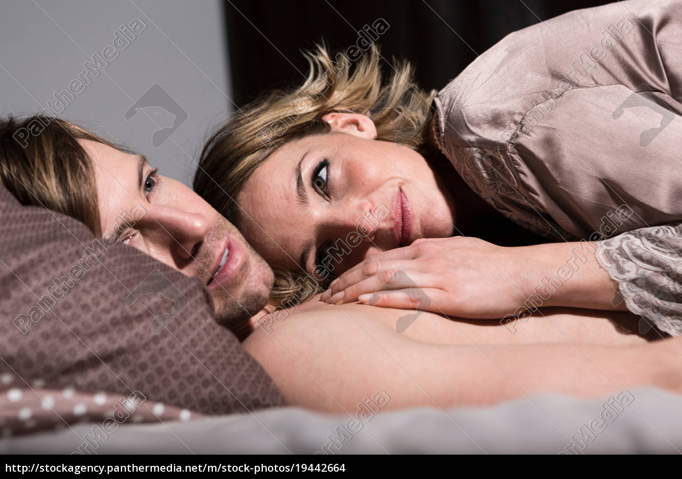 couple, in, bed, , woman, touching, man's - 19442664