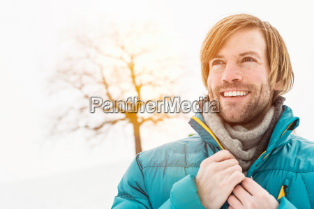 portrait of man wearing blue ski