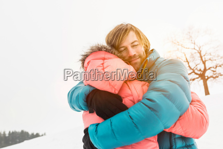 mid adult couple embracing