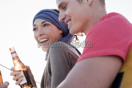 couple on yacht woman holding beer