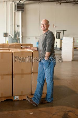 portrait of male warehouse worker by