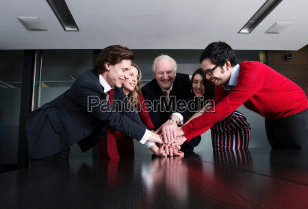 business team putting their hands on
