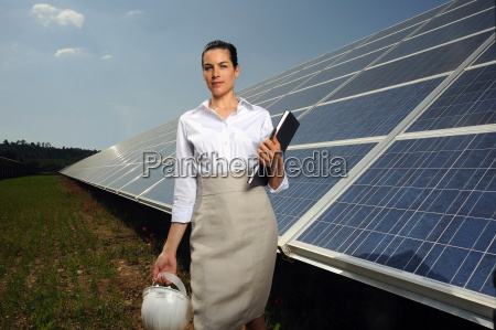 business woman in front of solar