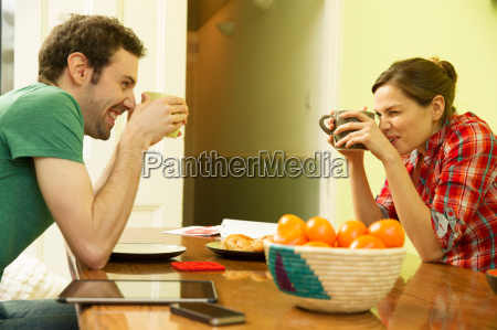 young couple holding coffee cups woman