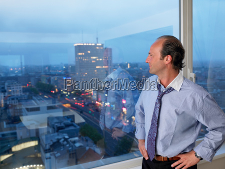 business man looking through the window