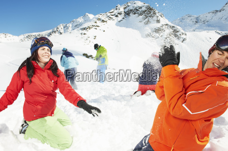 friends having snowball fight kuhtai austria