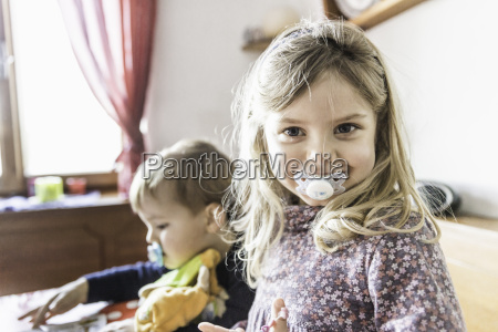 children with pacifiers playing