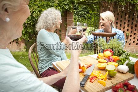 three generation women raising a glass
