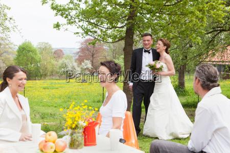 newlywed couple walking to reception