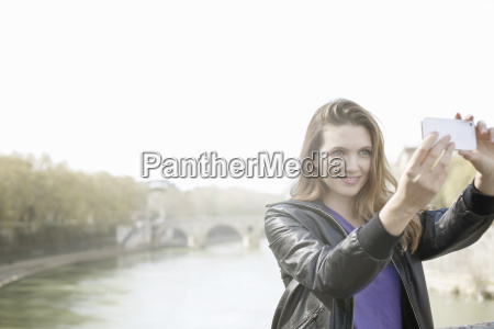 young woman taking a picture of