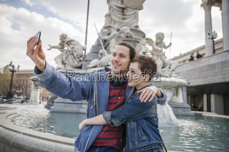 young adult couple taking picture of