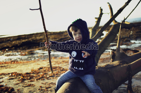 boy on troon beach ayrshire scotland