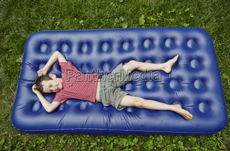 overhead view of boy lying on