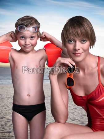 mother and son on beach together