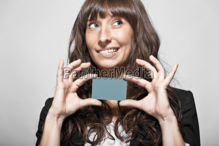 businesswoman holding card