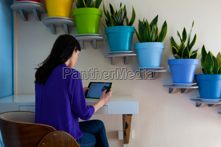 woman making payment on digital tablet