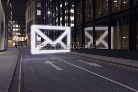 glowing email icon in street at