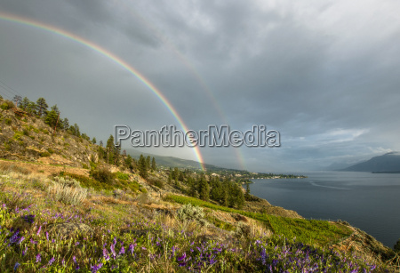 summer storm and double rainbow over