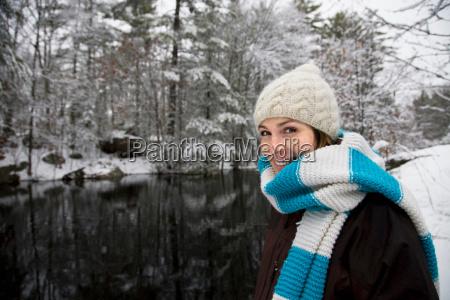 woman smiling in winter landscape