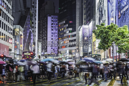 crowded pedestrian crossing at night hong