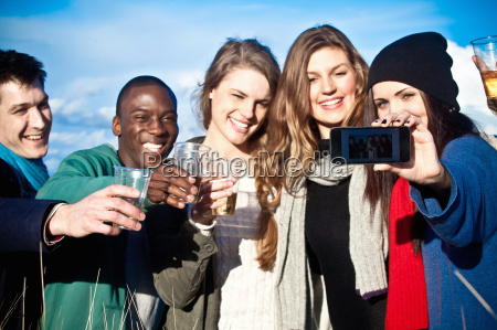 young adult friends toasting with white