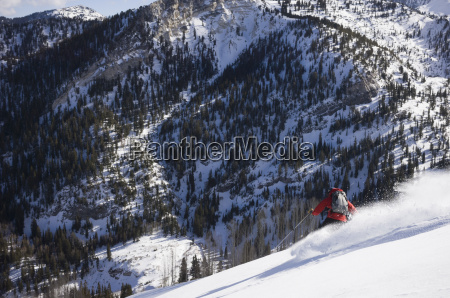 man backcountry skiing the meadows silverfork
