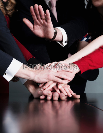 closeup of business team putting their