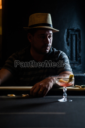 mid adult man sitting at table