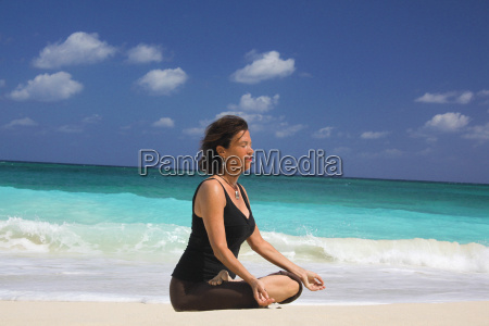 mature woman in lotus position on