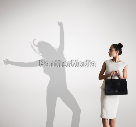 woman with shadow in background dancing