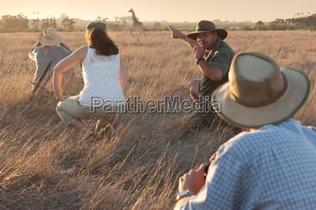 people watching giraffe on safari stellenbosch