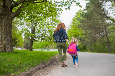 rear view of mother and daughter