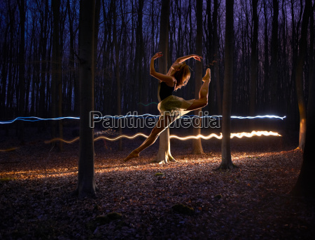 female dancer jumping mid air in