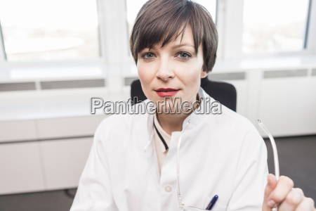 mid adult woman wearing white coat