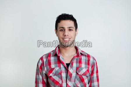 portrait of young hispanic man studio
