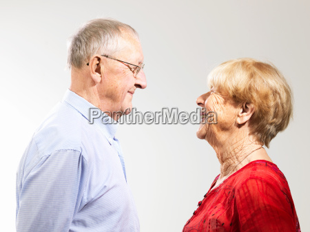 senior couple standing face to face