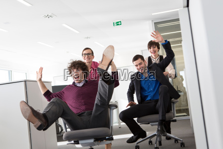 office workers pushing men on office