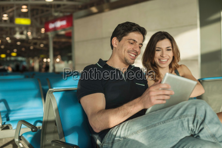 young couple using digital tablet in
