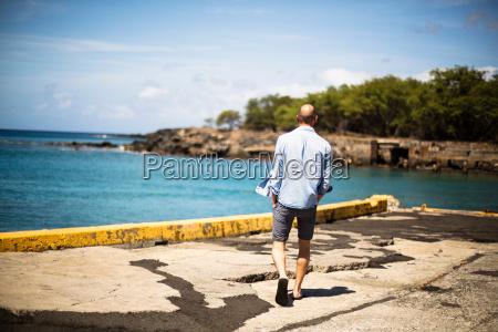 mid adult man walking on pier