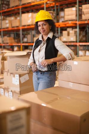 portrait of female warehouse worker leaning